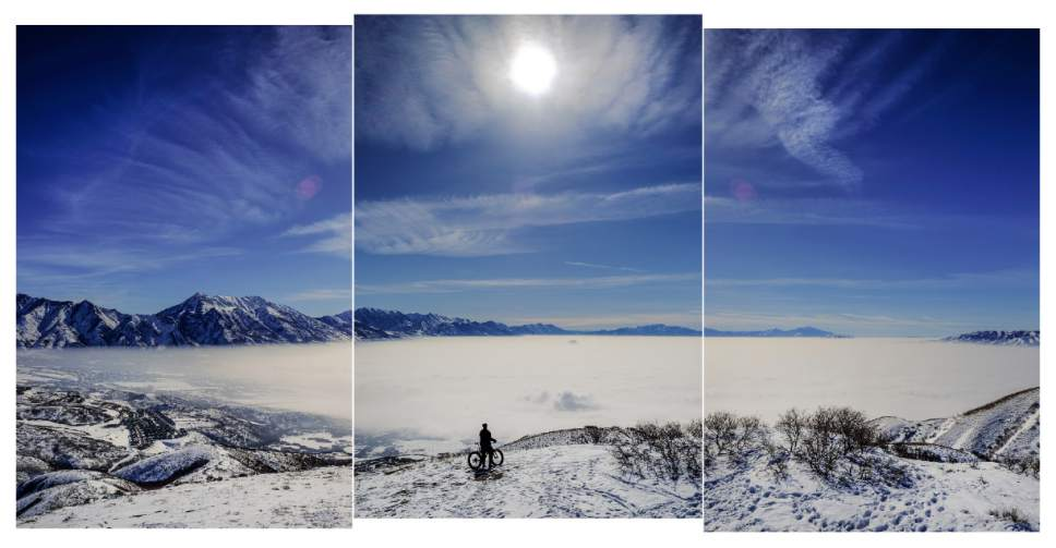 Francisco Kjolseth | The Salt Lake Tribune Jason Dunn of Draper seeks higher, cleaner air as he rides his bike to a peak overlooking an obscured Utah County in February 2016.