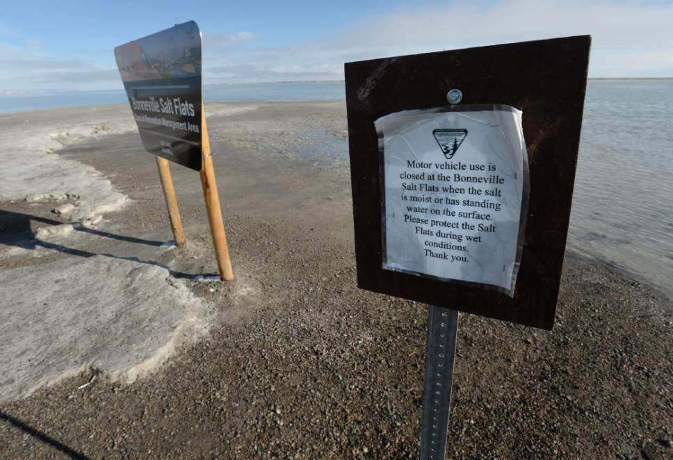 Steve Griffin / The Salt Lake Tribune  A sign warns drivers not to drive on the mud at the end of the road at Bonneville Salt Flats International Speedway Monday January 2, 2017.