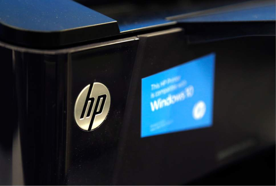 This Tuesday, May 24, 2016, photo shows an HP printer on display at a store, in North Andover, Mass. Each year, business owners can count on changes in tax law and other rules. For 2017, small businesses are getting a bigger deduction for equipment purchases, and those that aren't required to provide health insurance will have an option to help staffers pay for coverage. (AP Photo/Elise Amendola)