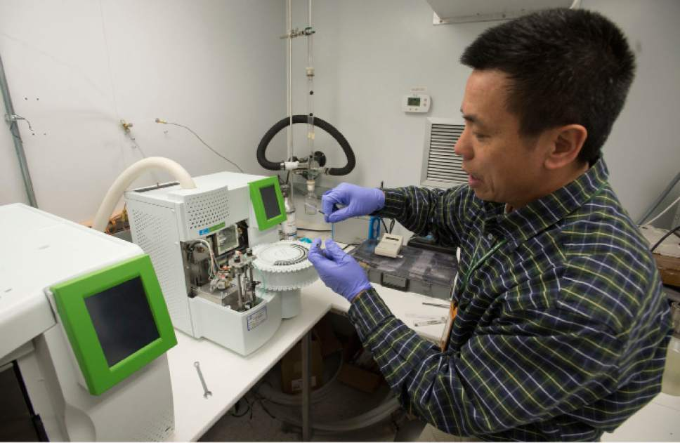 Steve Griffin  |  The Salt Lake Tribune   Michael Yang, scientist for air monitoring standards of the Division of Air Quality for the Utah Department of Environmental Quality performs maintenance for monitoring devices at the Hawthorne Elementary monitoring station. The Utah Division of Air Quality operates a network of air monitoring stations measuring particulates and other pollutants in our air.in the play ground at Hawthorne Elementary School  in Salt Lake City, Monday, February 22, 2016.