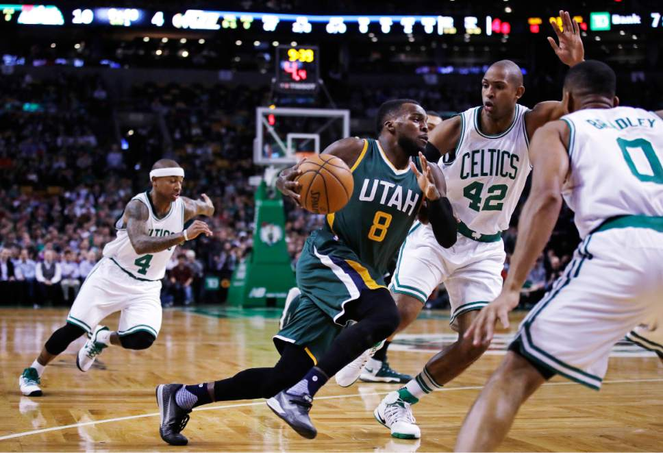 Utah Jazz guard Shelvin Mack (8) drives to the basket against the Boston Celtics during the first quarter of an NBA basketball game in Boston, Tuesday, Jan. 3, 2017. (AP Photo/Charles Krupa)