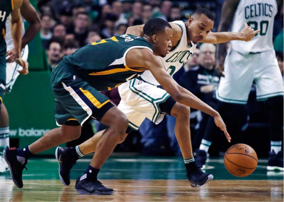 Boston Celtics guard Avery Bradley, right, pressures Utah Jazz guard Rodney Hood (5) during the second half of an NBA basketball game in Boston, Tuesday, Jan. 3, 2017. The Celtics defeated the Jazz 115-104. (AP Photo/Charles Krupa)