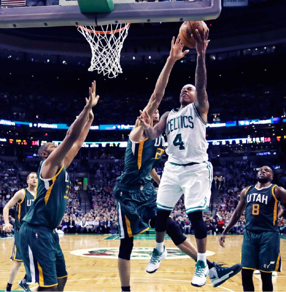 Boston Celtics guard Isaiah Thomas (4) drives to the basket against the Utah Jazz during the second half of an NBA basketball game in Boston, Tuesday, Jan. 3, 2017. Thomas scored 29 points as the Celtics defeated the Jazz 115-104. (AP Photo/Charles Krupa)