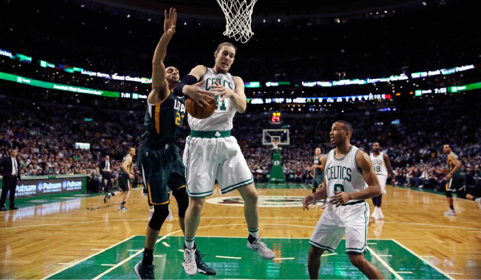 Boston Celtics center Kelly Olynyk (41) grabs a rebound against Utah Jazz center Rudy Gobert (27) during the first quarter of an NBA basketball game in Boston, Tuesday, Jan. 3, 2017. (AP Photo/Charles Krupa)