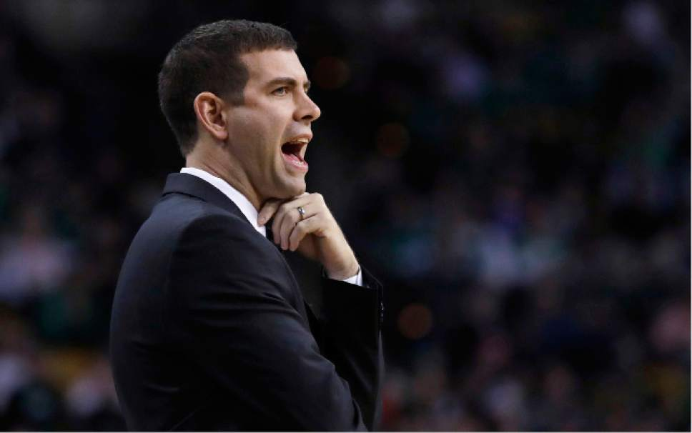 Boston Celtics head coach Brad Stevens calls to his players during the first quarter of an NBA basketball game against the Utah Jazz in Boston, Tuesday, Jan. 3, 2017. (AP Photo/Charles Krupa)