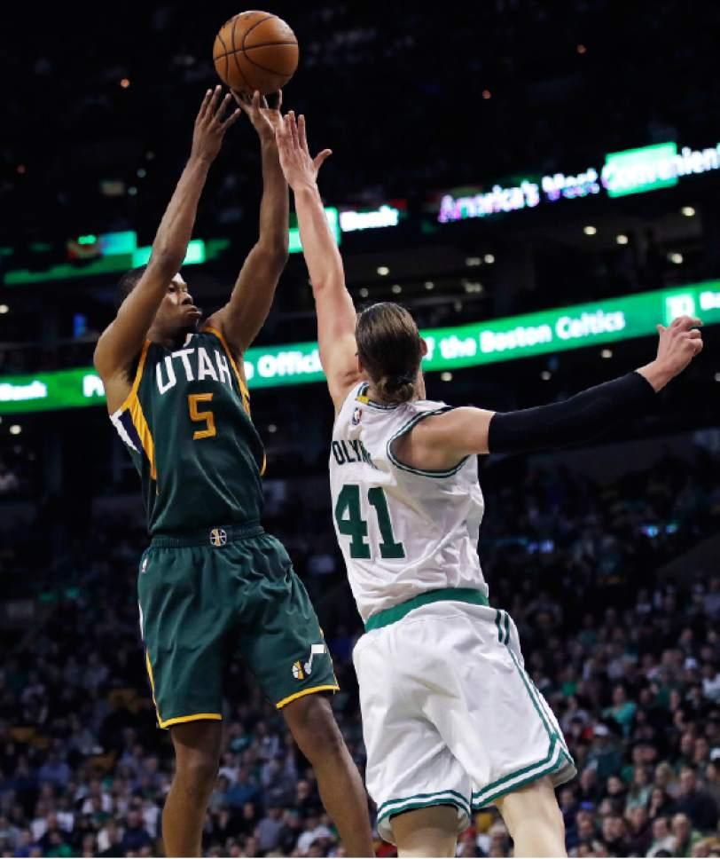 Utah Jazz guard Rodney Hood (5) shoots over Boston Celtics center Kelly Olynyk (41) during the first quarter of an NBA basketball game in Boston, Tuesday, Jan. 3, 2017. (AP Photo/Charles Krupa)