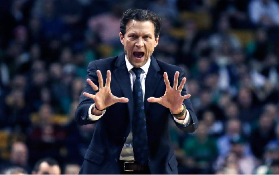 Utah Jazz head coach Quin Snyder calls to his players during the first quarter of an NBA basketball game against the Boston Celtics in Boston, Tuesday, Jan. 3, 2017. (AP Photo/Charles Krupa)