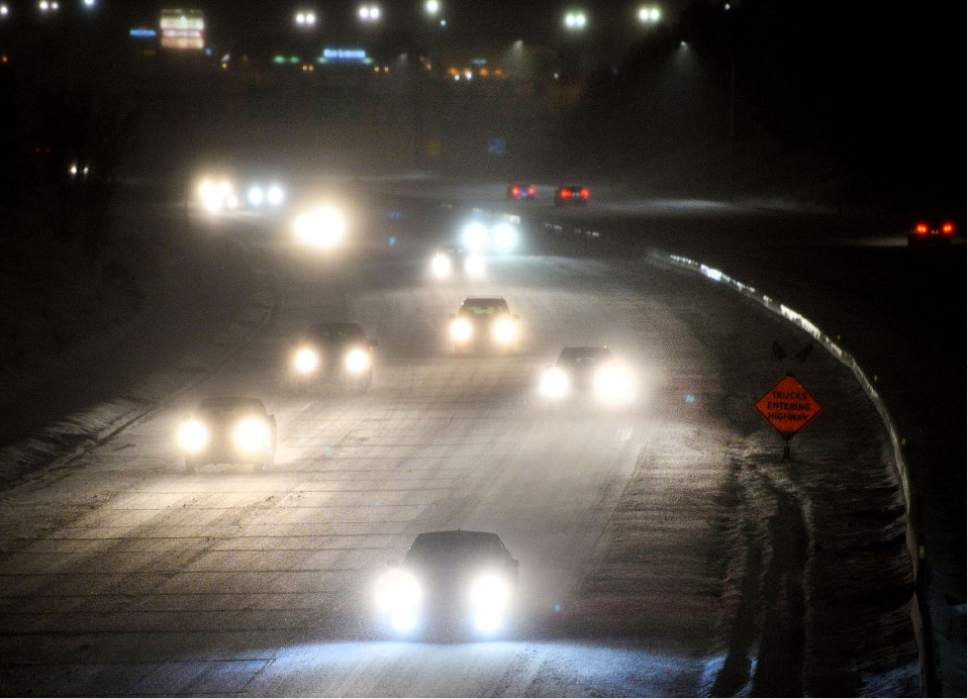 Steve Griffin  |  The Salt Lake Tribune Traffic along I-80 near 2000 East slows as a winter storm whips through the Wasatch Front on Wednesday evening.