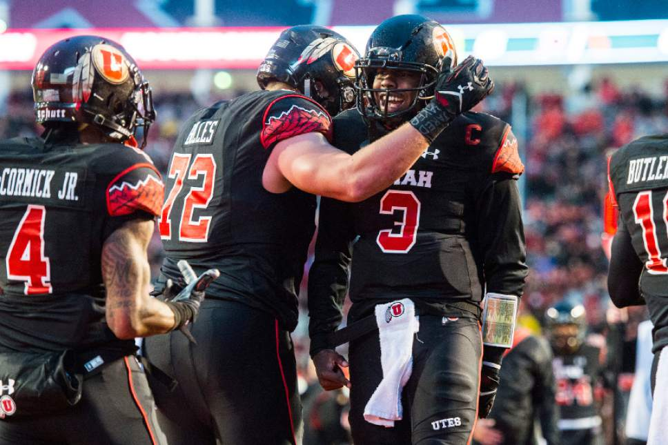 Chris Detrick  |  The Salt Lake Tribune Utah Utes offensive lineman Garett Bolles (72) and Utah Utes quarterback Troy Williams (3) celebrate after Williams' touchdown during the first half of the game at Rice-Eccles Stadium Friday September 23, 2016.
