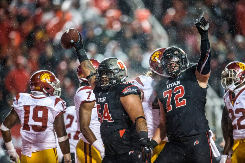 Chris Detrick  |  The Salt Lake Tribune Utah Utes offensive lineman Isaac Asiata (54) and Utah Utes offensive lineman Garett Bolles (72) celebrate after Asiata recovered a touchdown and scored a touchdown during the game at Rice-Eccles Stadium Friday September 23, 2016. Utah Utes defeated USC Trojans 31-27.