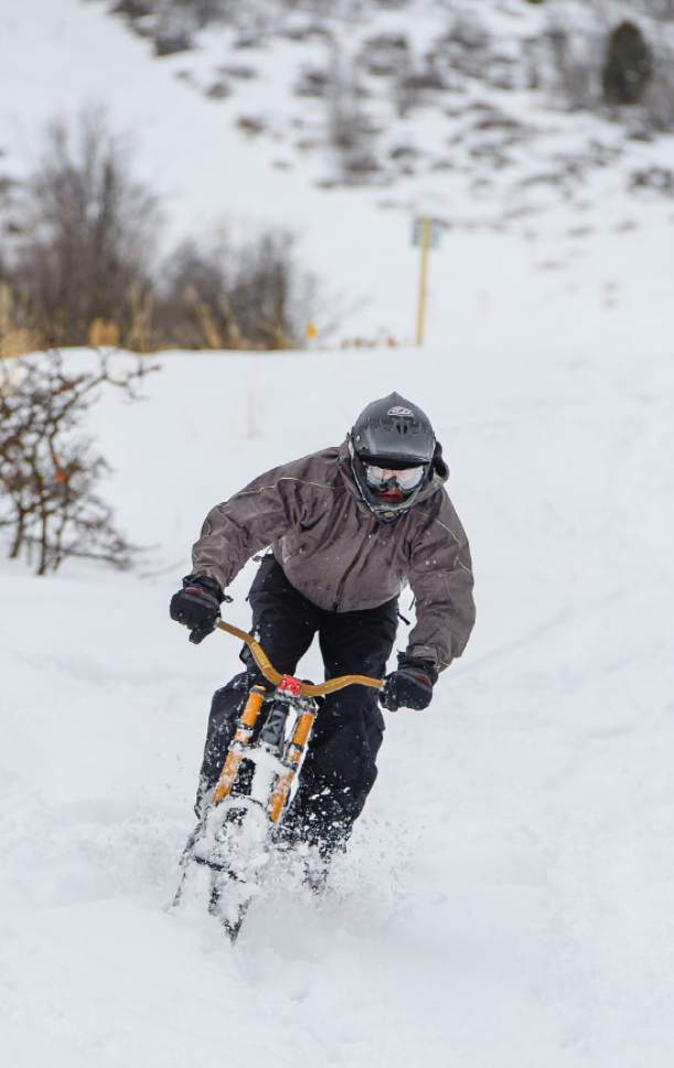 Francisco Kjolseth | The Salt Lake Tribune Mike Johnson of Salt Lake slides the tail of his ski bike as he descends from the top of Emigration Canyon on Wednesday, Jan. 4, 2016.