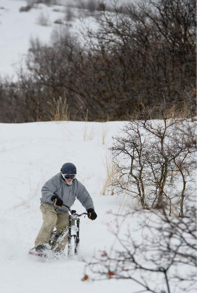 Francisco Kjolseth | The Salt Lake Tribune Mike Kerr of Salt Lake glides down a slope from the top of Emigration Canyon with the aid of a ski bike on Wednesday, Jan. 4, 2016.