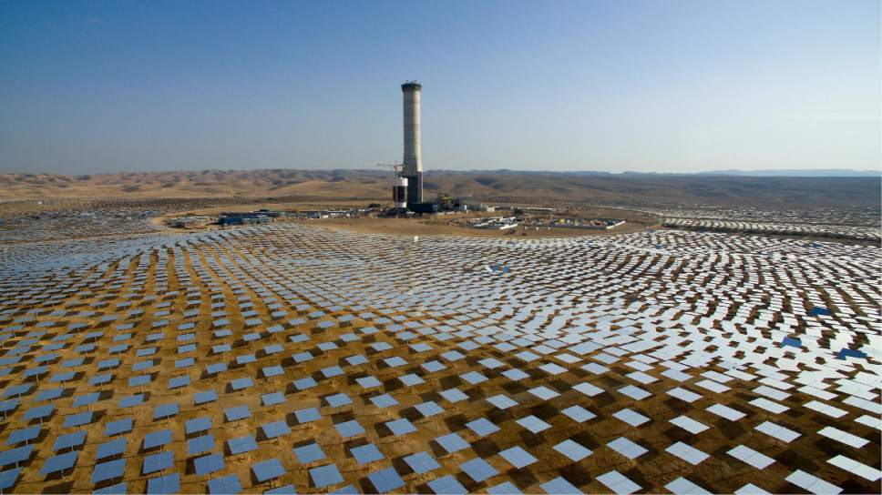 In this Dec. 22, 2016 photo, 50,000 mirrors, known as heliostats,encircle the solar tower in the Negev desert, near in Ashelim, southern Israel. In sunny Israel, solar energy supplies just a small percentage of the nation's power needs, leaving it trailing far behind countries with cloudier and colder climates. Now it is trying to turn that around with a large-scale project, highlighted by the world's tallest solar tower, that could mark a giant leap for the country's fledgling renewable energy industry.  (AP Photo/Oded Balilty)