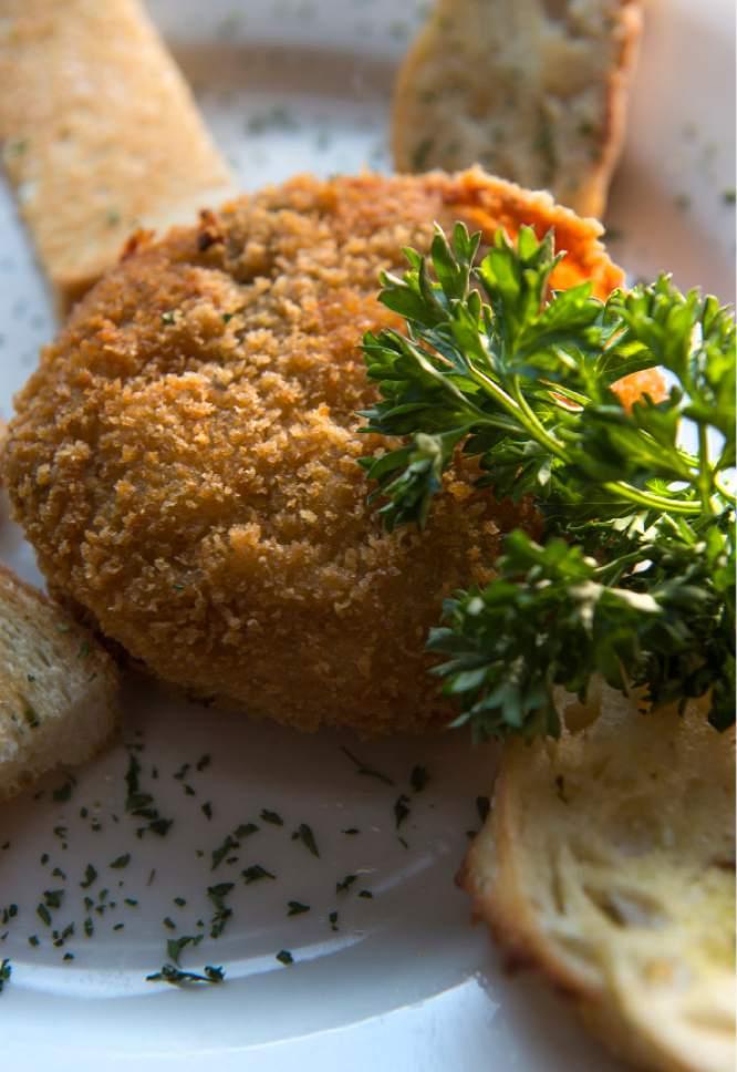 Leah Hogsten  |  The Salt Lake Tribune The Eating Establishment's spinach and artichoke dip stuffed onion rings, $10.