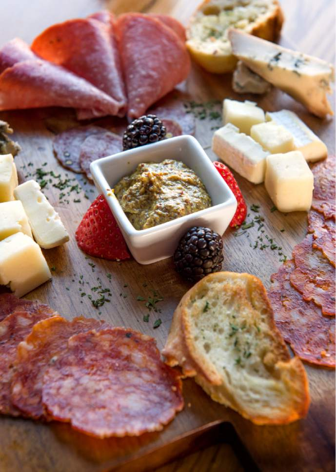 Leah Hogsten  |  The Salt Lake Tribune The meat and cheese board with Creminelli calabrese, Avalanche finocchiona, asiago pressato and gorgonzola piccante,  at The Eating Establishment in Park City, which was recently purchased by the owners of Bar X and Beer Bar in Salt Lake City.