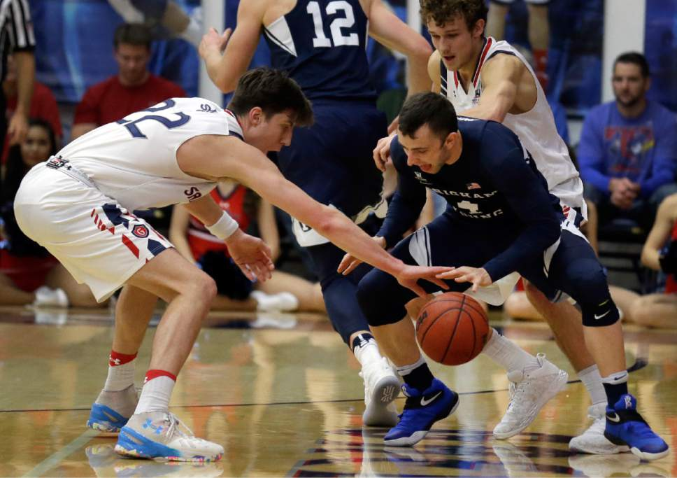 Saint Mary's Dane Pineau, left, guards against BYU guard Nick Emery during the first half of an NCAA college basketball game Thursday, Jan. 5, 2017, in Moraga, Calif. (AP Photo/Ben Margot)