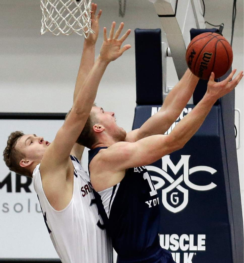 BYU forward Eric Mika, right, shoots against Saint Mary's Jock Landale during the first half of an NCAA college basketball game Thursday, Jan. 5, 2017, in Moraga, Calif. (AP Photo/Ben Margot)