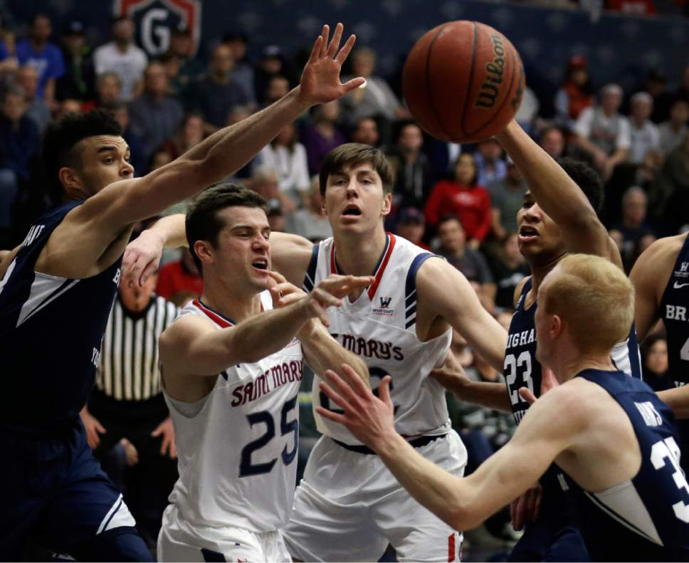 BYU forward Yoeli Childs (23) tries to block the shot of Saint Mary's Joe Rahon (25) during the first half of an NCAA college basketball game Thursday, Jan. 5, 2017, in Moraga, Calif. (AP Photo/Ben Margot)