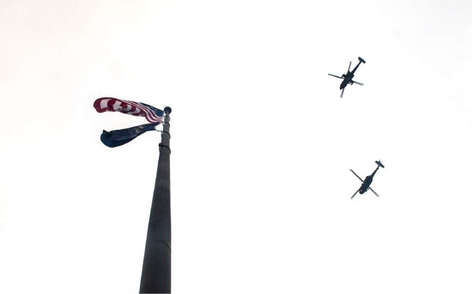 Leah Hogsten  |  The Salt Lake Tribune Three Pack 75 howitzers fire in a 19-gun salute as Utah National Guard helicopters fly over at the conclusion of the 2017 State Inaugural Ceremony for Gov. Gary R. Herbert, January 4, 2017 at the Utah State Capitol.