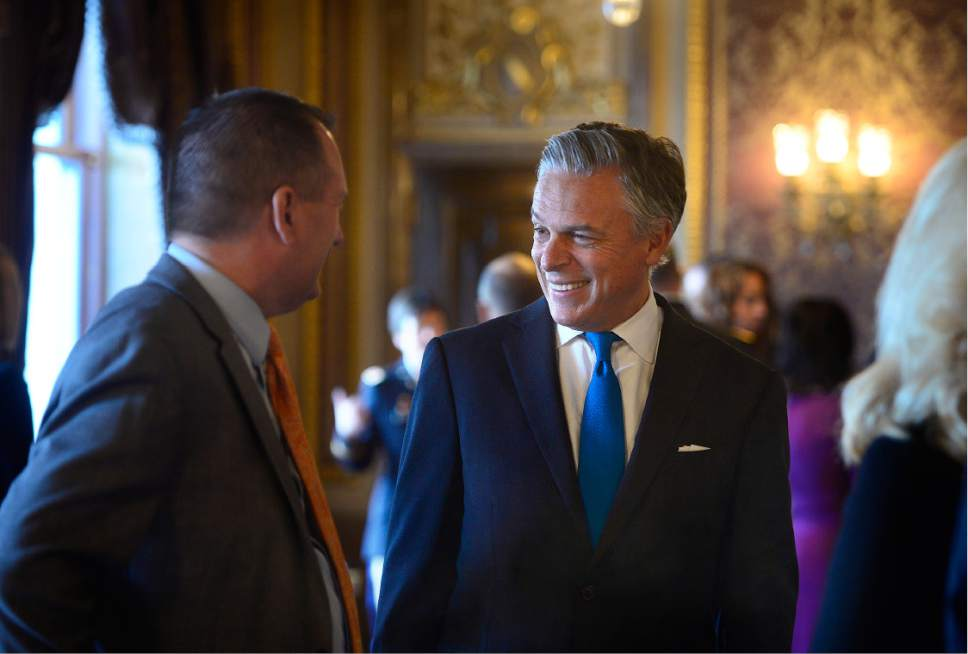 Scott Sommerdorf   |  The Salt Lake Tribune   Utah Auditor John Dougall, left, speaks with former Utah Governor and United States Ambassador, Jon M. Hunstman Jr. prior to the State of Utah's Inaugural Ceremony in during a gathering in the Gold Room, Wednesday, January 4, 2017.