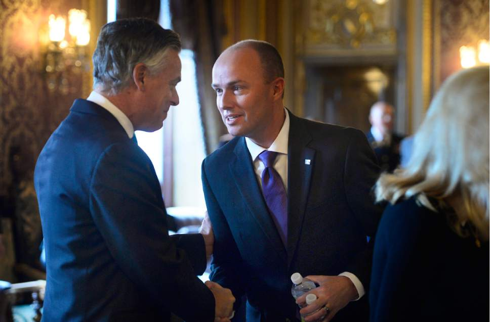 Scott Sommerdorf   |  The Salt Lake Tribune   Utah Lieutenant Governor Spencer J. Cox, left, stops to greet former Utah Governor and United States Ambassador, Jon M. Hunstman Jr. prior to the State of Utah's Inaugural Ceremony in during a gathering in the Gold Room, Wednesday, January 4, 2017.