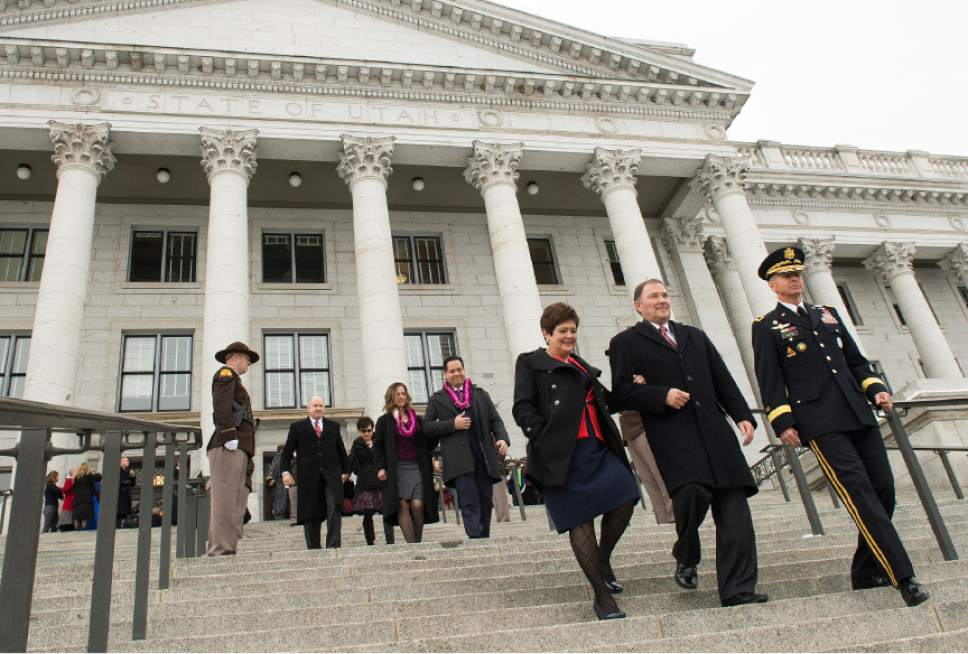 Leah Hogsten  |  The Salt Lake Tribune l-r Utah First Lady Jeanette Herbert, Gov. Gary Herbert and Major General Jeff Burton leave the Utah Capitol at the conclusion of the 2017 State Inaugural Ceremony, January 4, 2017.