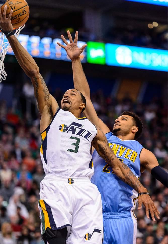 Trent Nelson     The Salt Lake Tribune Utah Jazz guard George Hill (3) goes to the basket, with Denver Nuggets guard Jamal Murray (27) defending as the Utah Jazz host the Denver Nuggets in Salt Lake City, Wednesday November 23, 2016.