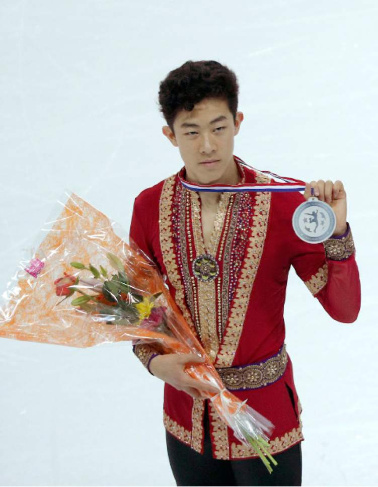 Nathan Chen of the U.S poses with the silver medal after the Men Skating Program during ISU Grand Prix of Figure Skating Final in Marseille, southern France, Saturday, Dec. 10, 2016. (AP Photo/Christophe Ena)