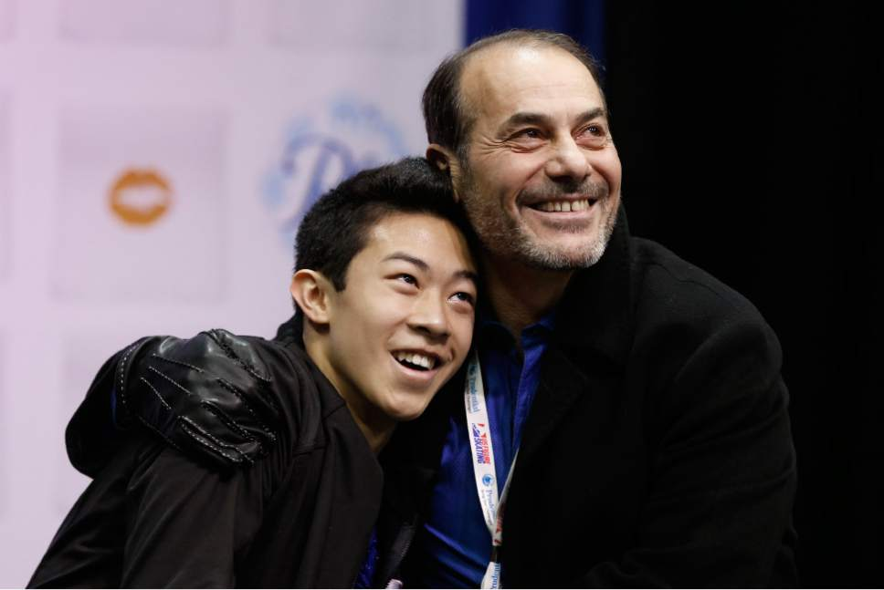 Nathan Chen, left, gets a hug from coach Rafael Arutyunian after he completed the men's free skate program of the U.S. Figure Skating Championships, Sunday, Jan. 24, 2016, in St. Paul, Minn. Chen picked up the bronze medal in the men's program. (AP Photo/Jim Mone)