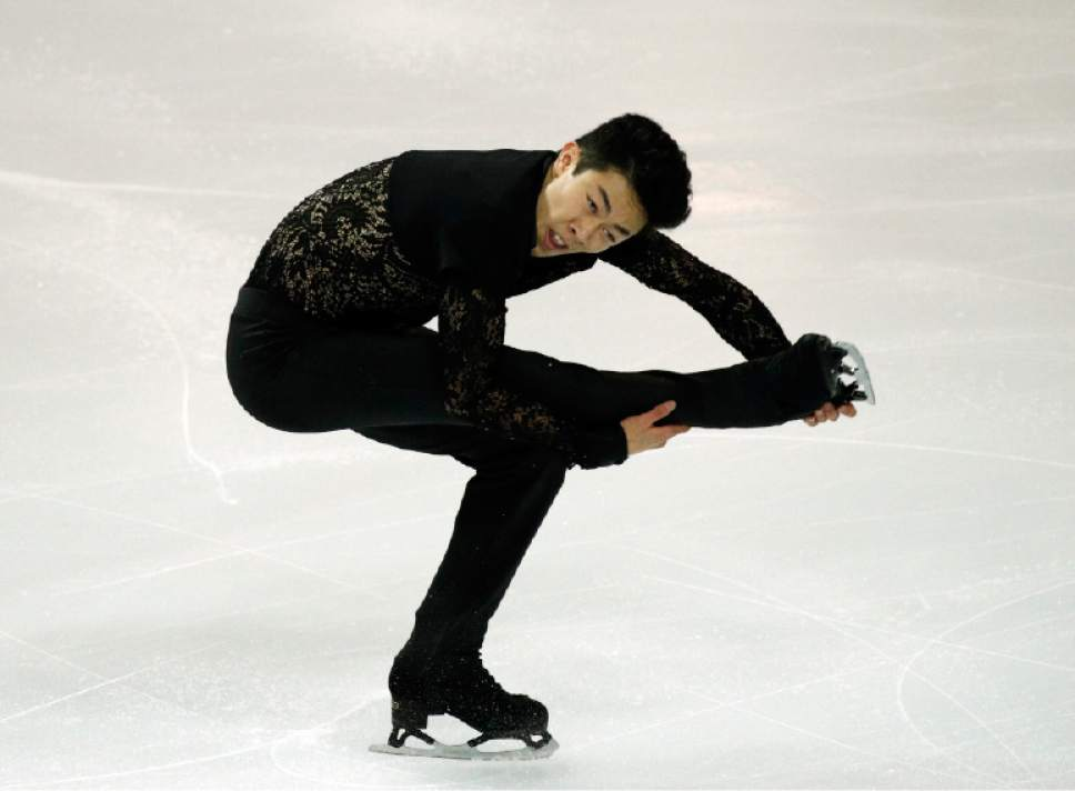 Nathan Chen of the U.S competes in the Men Short Program during ISU Grand Prix of Figure Skating Final in Marseille, southern France, Thursday, Dec. 8, 2016. (AP Photo/Christophe Ena)