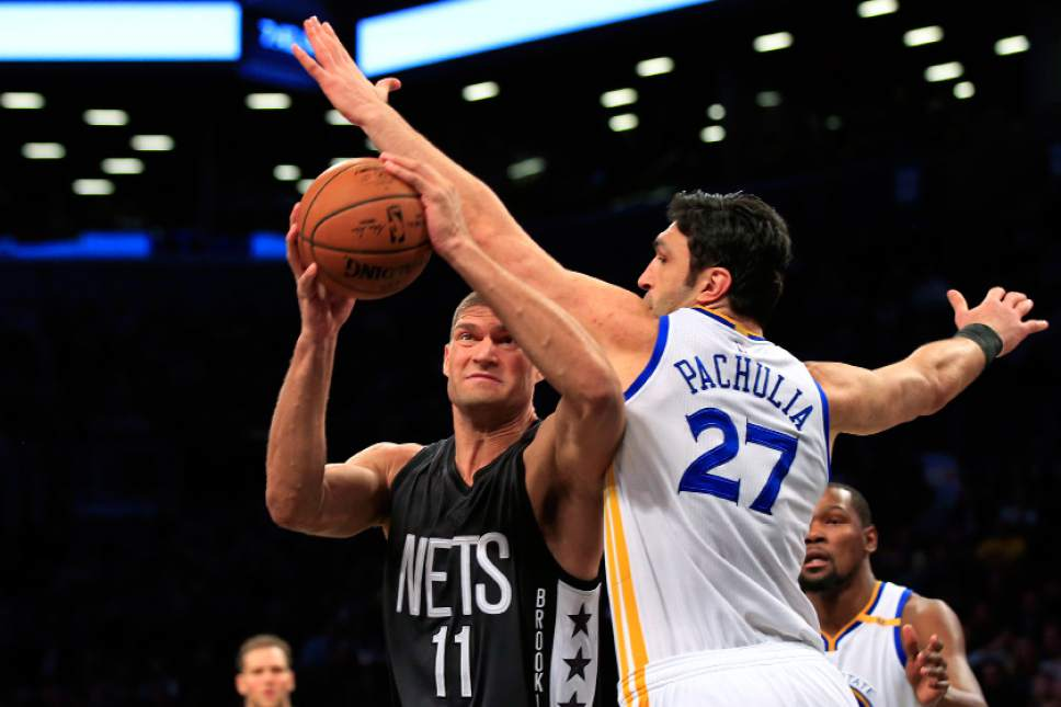 964b9dd59 Brooklyn Nets center Brook Lopez (11) drives to the basket past Golden  State Warriors Zaza Pachulia ...