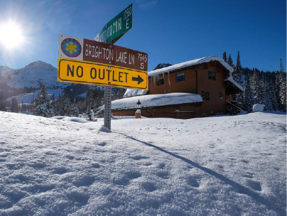 Francisco Kjolseth  |  The Salt Lake Tribune Deep snow obscures a street sign at Brighton on Friday. With recent storms, Utah has about half of the snow it needs to end the current drought this spring, according to the Natural Resources Conservation Service. Snowpack above the Salt Lake City and Provo areas is currently sitting at 150 percent of normal. But there are months to go before spring runoff, officials caution. Snowpack was above normal last year at this time, but it ultimately became a lackluster snow season.