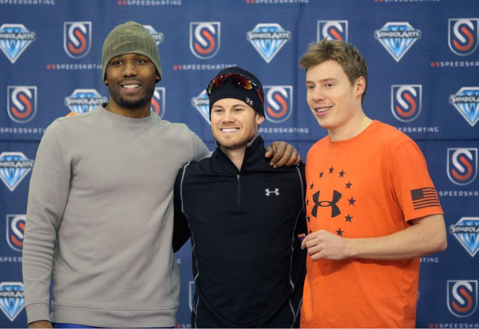 First-place finisher Joey Mantia, center, second-place finisher Shani Davis, left, and third-place finisher Brian Hansen stand on the podium after competing in the men's 1,500 meters U.S. long track speedskating championship at Utah Olympic Oval, Saturday, Jan. 7, 2017, in Kearns, Utah. (AP Photo/Rick Bowmer)