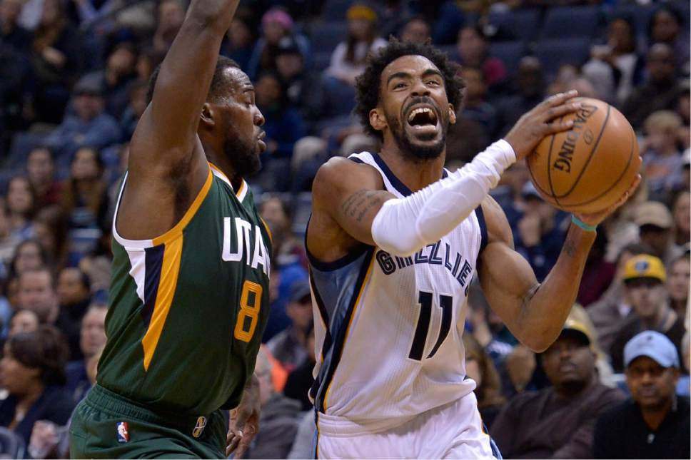 Memphis Grizzlies guard Mike Conley (11) drives against Utah Jazz guard Shelvin Mack (8) in the first half of an NBA basketball game Sunday, Jan. 8, 2017, in Memphis, Tenn. (AP Photo/Brandon Dill)