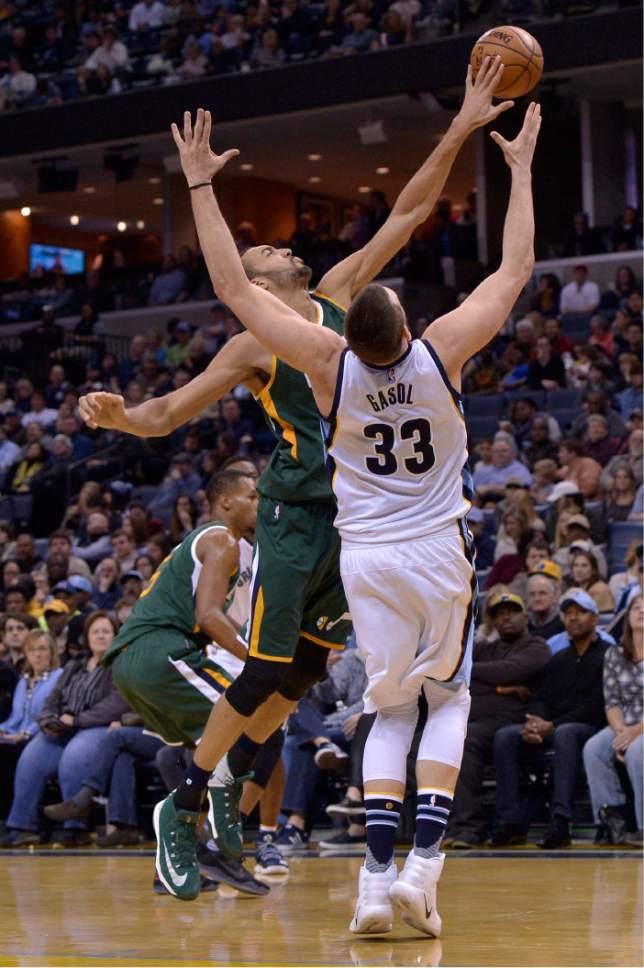 Memphis Grizzlies center Marc Gasol (33) and Utah Jazz center Rudy Gobert battle for a rebound in the first half of an NBA basketball game Sunday, Jan. 8, 2017, in Memphis, Tenn. (AP Photo/Brandon Dill)