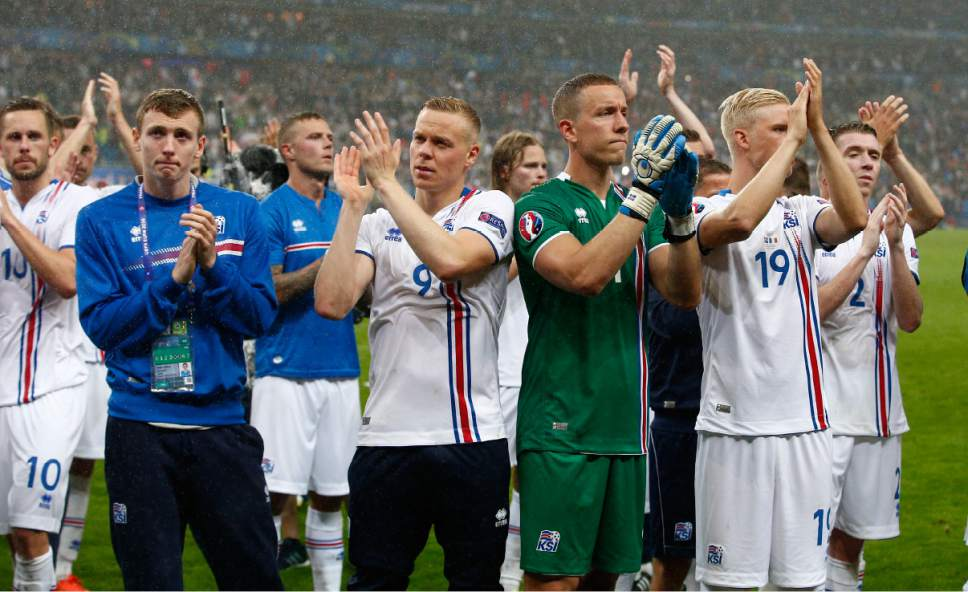 FILE - In this Sunday, July 3, 2016 file photo, Iceland's players applauds supporters at the end of the Euro 2016 quarterfinal soccer match between France and Iceland, at the Stade de France in Saint-Denis, north of Paris, France. FIFA is about to make the World Cup a bigger and, it hopes, richer event even at the cost of lower quality soccer. FIFA President Gianni Infantino hopes his ruling Council will agree Tuesday, Jan. 10, 2017 to expand the 2026 World Cup to 48 nations, playing in 16 groups of three teams. (AP Photo/Thibault Camus, File)
