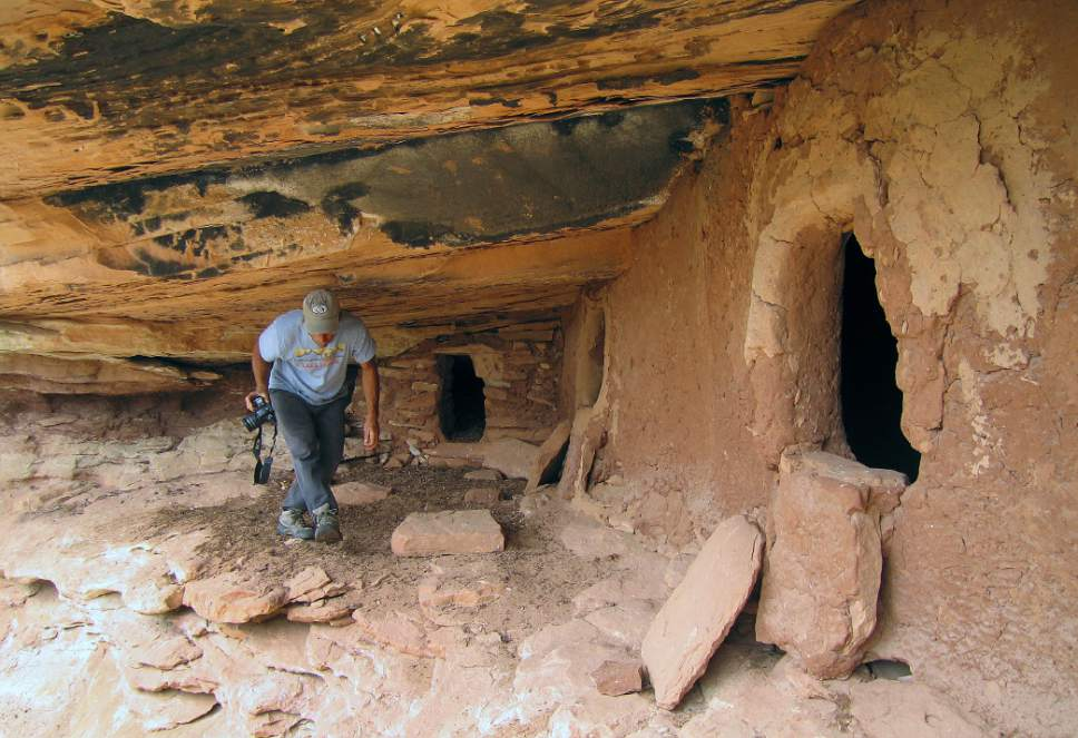 Al Hartmann  |  Tribune file photo Backpacker explores an unknown Anasazi ruin under a sandstone alcove in a canyon on Cedar Mesa in San Juan County.  The area is included in the Bears Ears National Monument.