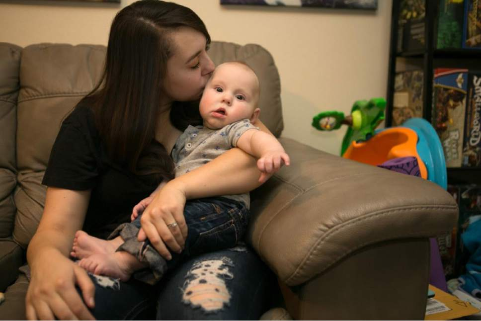 Jud Burkett special to The Salt Lake Tribune  Kaitlyn, who was sexually assaulted as a freshman at Southern Utah University, kisses her 5-month-old son at the Cedar City home they share with her husband. She agreed to the use of her first name. Unlike many college students who are assaulted, Kaitlyn stayed in classes at her school, and she graduated in December. Cedar City police told her that her assailant had been banned from campus, which she said helped her feel safe and focus on school.