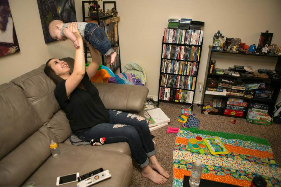 Jud Burkett special to The Salt Lake Tribune  Kaitlyn, who was sexually assaulted as a freshman at Southern Utah University, plays with her 5-month-old son at the Cedar City home they share with her husband. She agreed to the use of her first name. Unlike many college students who are assaulted, Kaitlyn stayed in classes at her school, and she graduated in December. Cedar City police told her that her assailant had been banned from campus, which she said helped her feel safe and focus on school.