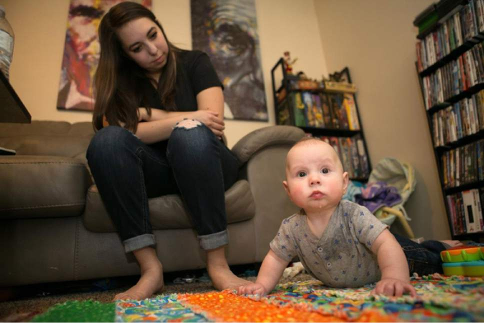 Jud Burkett special to The Salt Lake Tribune  Kaitlyn, who was sexually assaulted as a freshman at Southern Utah University, watches her 5-month-old son at the Cedar City home they share with her husband. She agreed to the use of her first name. Unlike many college students who are assaulted, Kaitlyn stayed in classes at her school, and she graduated in December. Cedar City police told her that her assailant had been banned from campus, which she said helped her feel safe and focus on school.