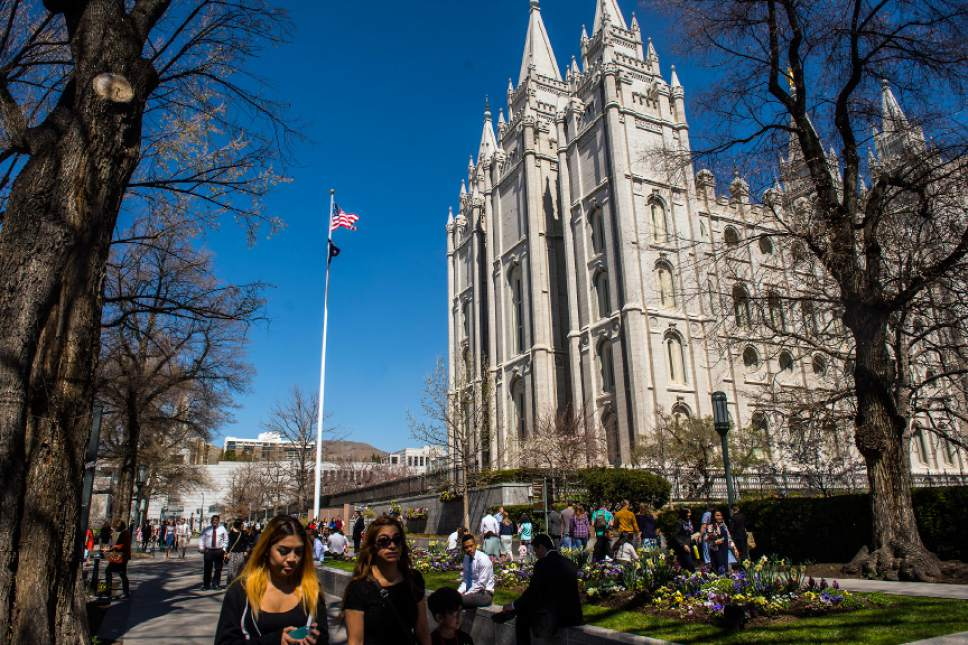 Chris Detrick  |  The Salt Lake Tribune Mormons walk around Temple Square before the afternoon session of the 186th LDS General Conference at the Conference Center in Salt Lake City Saturday April 2, 2016.