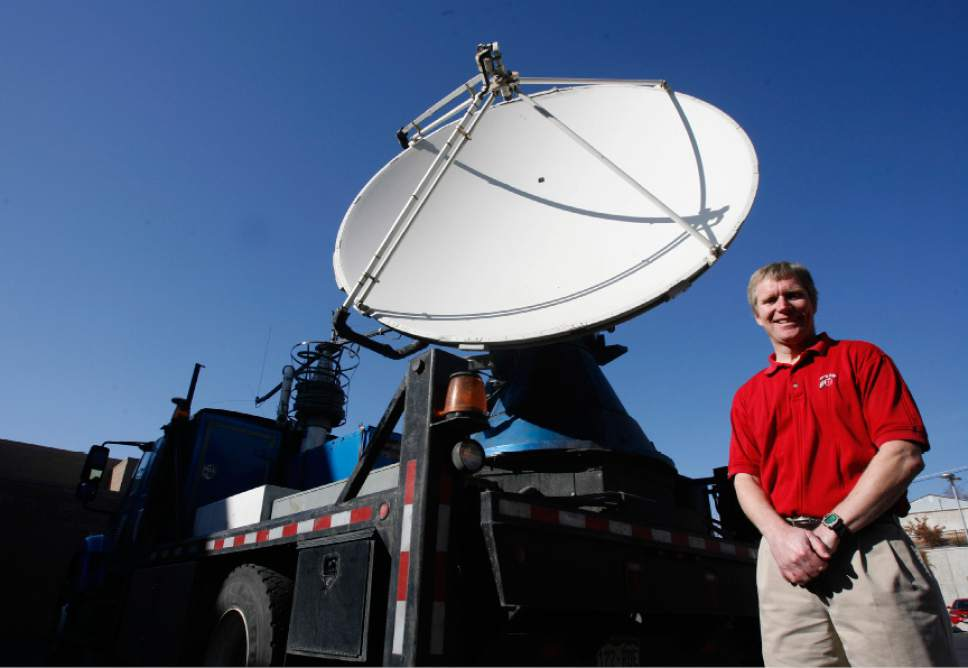 "Rick Egan  | Tribune file photo   Jim Steenburgh is dwarfed by the National Science Foundation's Doppler on Wheels, or DOW 6, on Thursday, Nov. 10, 2011. Steenburgh says there's a ""period of uncertainty and anxiety"" following President-elect Trump's suggestion to defund NASA's climate research."