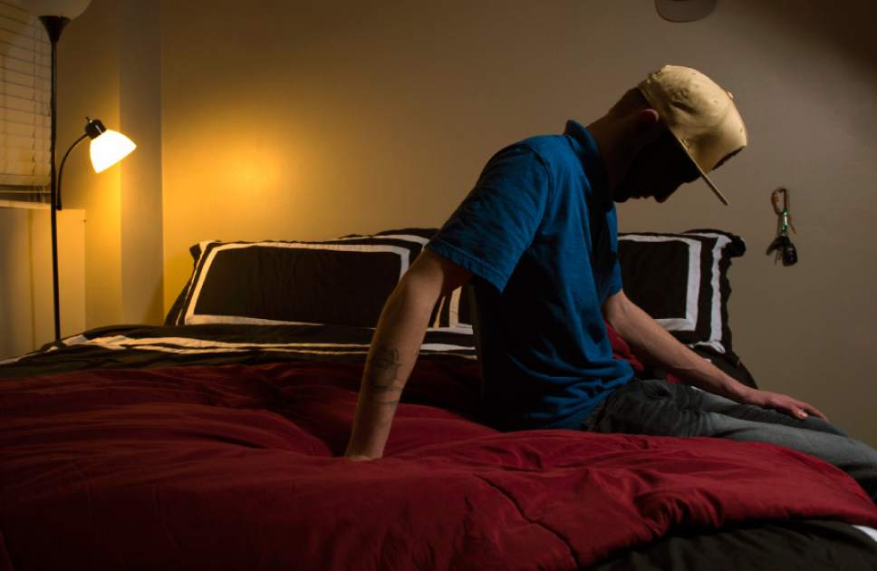 Leah Hogsten  |  The Salt Lake Tribune A 17-year-old was left with the clothes on his back and shoes on his feet after he was emancipated from his mother, 14 days prior to this photo being taken. Pictured in his bedroom, December 23, 2016, of his best friend's home in which he now lives, he said having a court-appointed attorney helped him immensely in resolving his misdemeanor cases and journey of becoming emancipated.