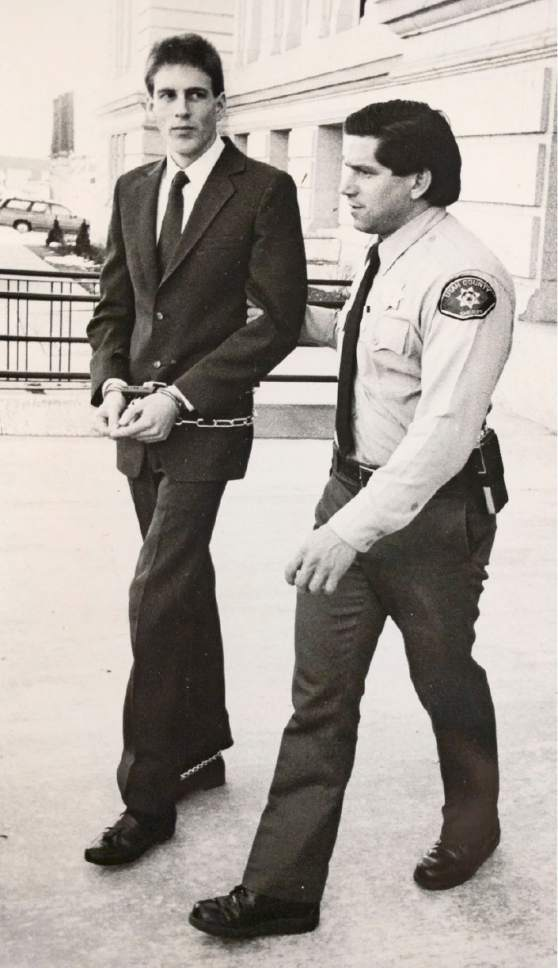 Tribune file photo  Lance Conway Wood is escorted Feb. 23, 1990, during his murder trial. Wood was convicted of murder in Southern Utah University student Gordon Church's 1988 killing.