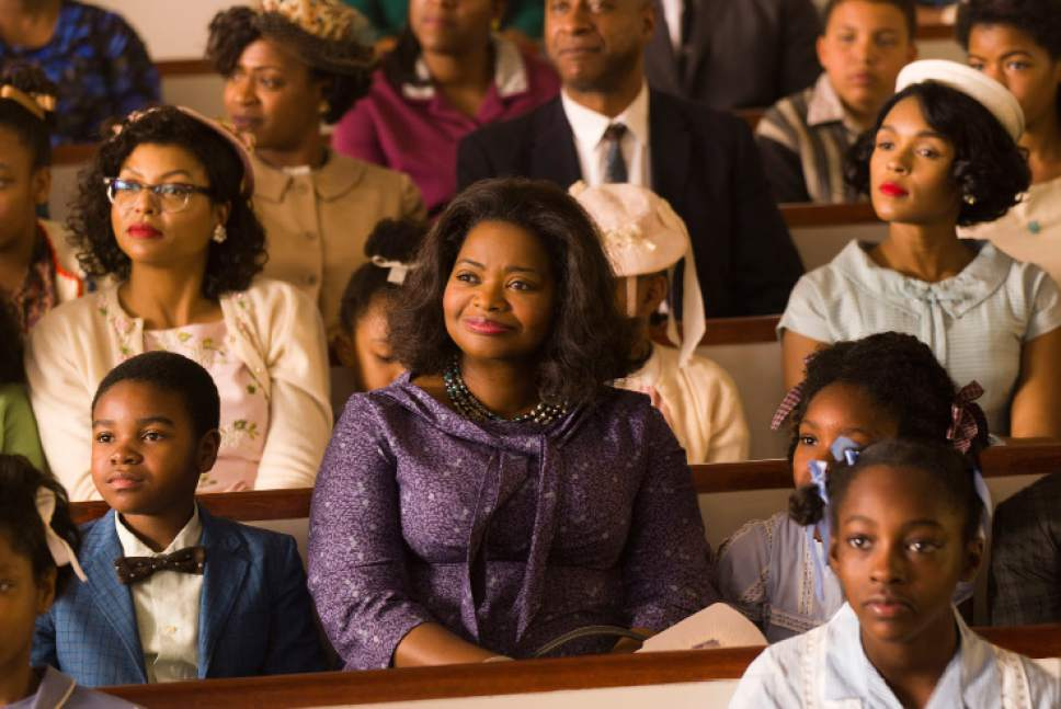 "This image released by Twentieth Century Fox shows Taraji P. Henson, background left, Octavia Spencer, center, and Janelle Monae, background right, in a scene from ""Hidden Figures."" (Hopper Stone/Twentieth Century Fox via AP)"
