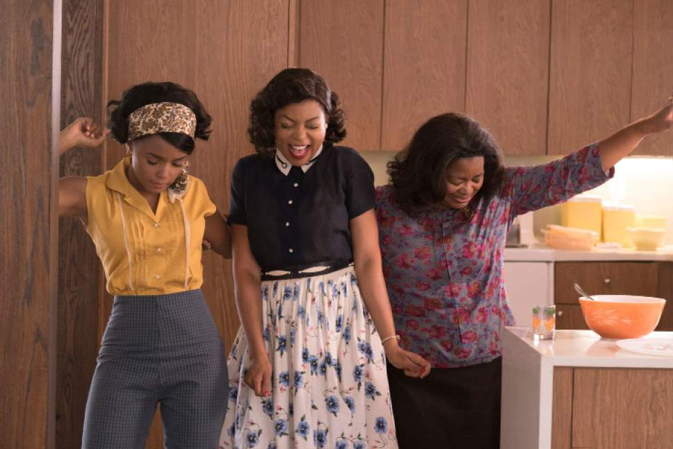 "This image released by Twentieth Century Fox shows Janelle Monae, from left, Taraji P. Henson and Octavia Spencer in a scene from ""Hidden Figures."" (Hopper Stone/Twentieth Century Fox via AP)"