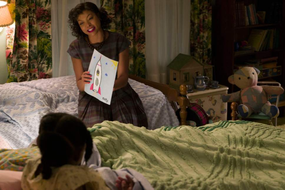 "This image released by Twentieth Century Fox shows Taraji P. Henson as Katherine Johnson in a scene from ""Hidden Figures."" (Hopper Stone/Twentieth Century Fox via AP)"