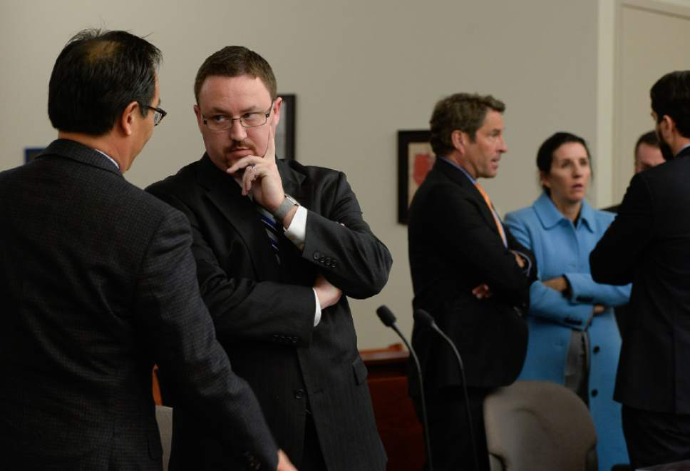 Francisco Kjolseth | The Salt Lake Tribune Prosecutors Blake Nakamura, left, and Scott Sutton confer with one another during an appearance by Chief Deputy for Utah Attorney General Kirk Torgensen at the Matheson Courthouse in Salt Lake City on Tuesday, Jan. 10, 2017, who was asking for an immediate release after prosecutors had him arrested to ensure he would show up for the February trial of former Utah Attorney General John Swallow. Judge Elizabeth Hruby-Mills ordered Torgensen be released, surrender his passport and appear in Utah on Feb. 8, 9, 10, to serve as a witness for prosecutors in Swallow's case.