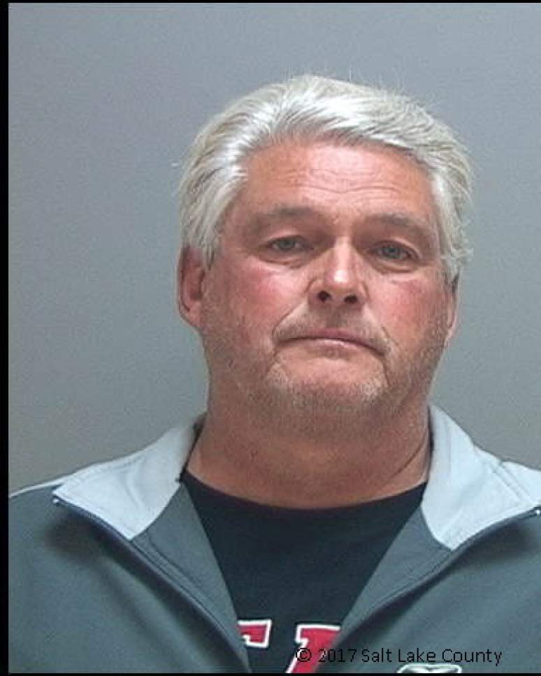 Courtesy of the Salt Lake County Sheriff's Office  Kirk Torgensen, former chief deputy attorney general for Utah, was arrested on a material witness warrant related to the case of John Swallow, and booked into jail Tuesday morning.