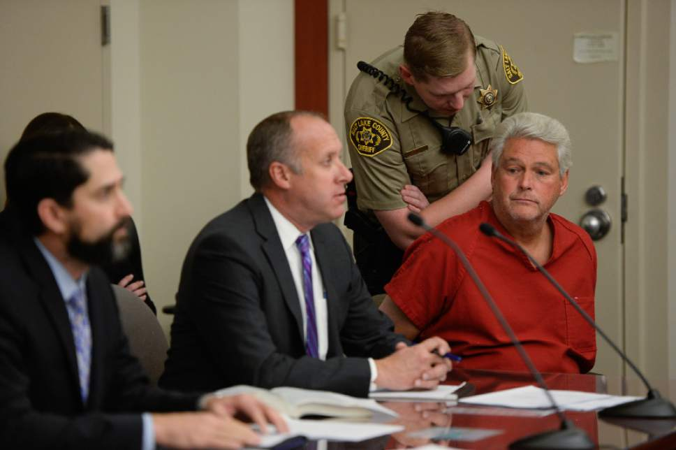 Francisco Kjolseth | The Salt Lake Tribune Former Chief Deputy for Utah Attorney General Kirk Torgensen, right, appears at the Matheson Courthouse in Salt Lake City on Tuesday, Jan. 10, 2017, alongside attorney's Brett Tolman, left, and Matt Lewis asking for an immediate release after prosecutors had him arrested to ensure he would show up for the February trial of former Utah Attorney General John Swallow. Judge Elizabeth Hruby-Mills ordered Torgensen be released, surrender his passport and appear in Utah on Feb. 8, 9, 10, to serve as a witness for prosecutors in Swallow's case.
